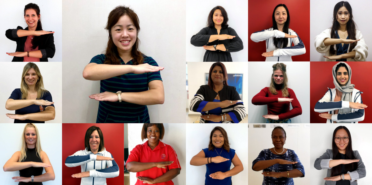 Our brilliant female colleagues show the each for equal sign to promote equality.